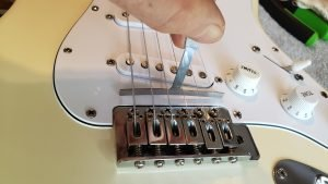 Setting saddle height on your guitar