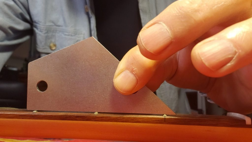 checking fret level on p-bass guitar