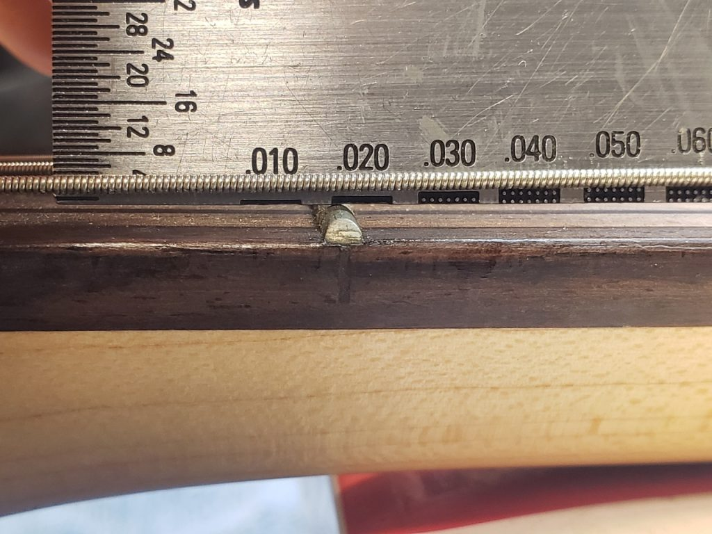 Measure relief of guitar neck