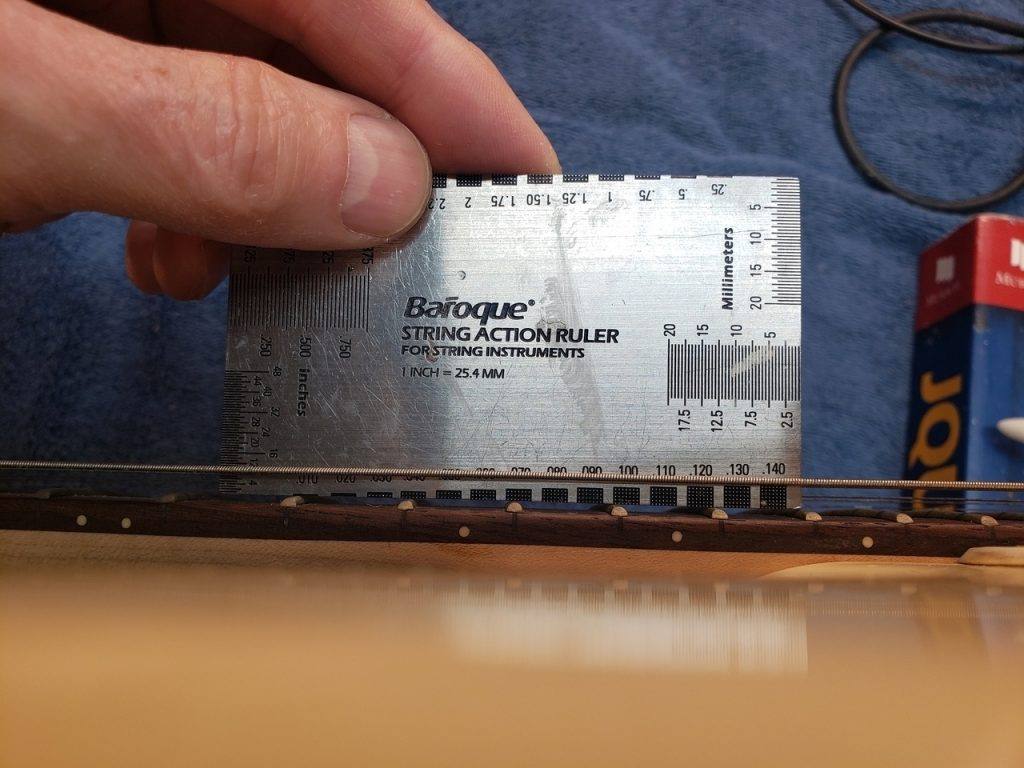 measuring string height on a squier guitar